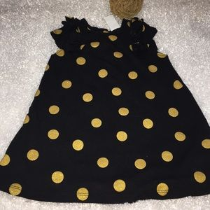 H&M's black and gold dress
